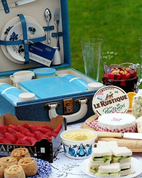 Picnic suitcase, strawberries, cheese and sandwiches